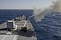 USS Jason Dunham fires a 5-inch deck gun. (8382933077).jpg