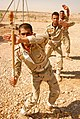 US Army 51773 A military policeman with the 12th Iraqi Army Division practices using a baton during riot control training at K-1 Military Base, Kirkuk, Iraq, Sept. 10. The training was conducted by Soldiers from th.jpg
