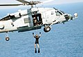 US Navy 001006-N-3896H-001 Search and Rescue swimmer is lowered from a helicopter.jpg
