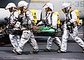 US Navy 030103-N-0119N-001 Crash and Salvage Rescue Team carries an injured sailor on a stretcher during a mass casualty drill.jpg