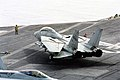 US Navy 030401-N-9951B-020 A flight deck director positions an F-14D Tomcat assigned to Fighter Squadron Thirty-One (VF-31) for launch from one of four steam powered catapults on the flight deck aboard USS Abraham Lincoln (CV.jpg