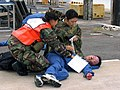 US Navy 030423-N-0000W-003 U.S. Navy Nurse Corps, Lt. Rhonda Bennett, from Kaneohe, Hawaii, and Hospital Intern Dr. Nao Kimoto from Tokyo, Japan, work together to help a simulated casualty during a bilateral disaster exercise.jpg