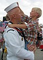 US Navy 030724-N-0879R-002 Electronics Technician 1st Class Michael Gray and his five-year-old son reunite.jpg