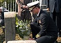 US Navy 031002-N-9860Y-003 Capt. J. Stephen Maynard, Commanding Officer, USS Blue Ridge (LCC 19), lays flowers on the gravesite of one of two American Sailors.jpg