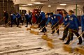 US Navy 040213-N-8774S-034 Sailors scrub down the ship's hangar bay aboard the nuclear powered aircraft carrier USS Harry S. Truman (CVN 75).jpg