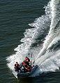 US Navy 040518-N-9742R-002 United States Coast Guardsmen in a Rigid Hull Inflatable Boat (RHIB) patrol the perimeter of the USS Enterprise (CVN-65).jpg