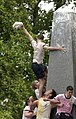 US Navy 040520-N-9693M-022 Midshipman Fourth Class Philip Johnson falls from the top of Herndon Monument while holding on to a prized Plebe dixie-cup cover.jpg