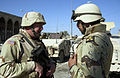 US Navy 041202-N-4614W-003 U.S. Navy Capt. Parsons confirms with his Iraqi National Guardsman counterpart (ING) on the next move security forces will take, after their visit to the Fallujah's Hydra Mosque.jpg