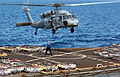 US Navy 050114-N-7130B-091 An MH-60S Knighthawk helicopter prepares to receive and transport ordnance from the Military Sealift Command ammunition ship USNS Flint (T-AE 32) to USS Ronald Reagan (CVN 76).jpg