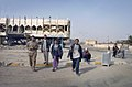 US Navy 050129-N-1810F-589 Iraqi citizens greet U.S. Navy Seabees assigned to Naval Mobile Construction Battalion Seven (NMCB 7) while on patrol in the streets of Fallujah, one day prior to Iraq's historic democratic elec.jpg