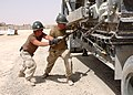 US Navy 050614-N-4958O-016 U.S. Navy Equipment Operators tighten chains that are holding a bulldozer on a 20-ton truck.jpg