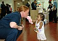 US Navy 060528-N-3714J-018 Navy Petty Officer 3rd Class Tammy Long, of Armour, S.D., plays with a child who is waiting to be seen by a doctor aboard the U.S. Navy's Military Sealift Command (MSC) hospital ship USNS Mercy.jpg
