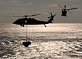 US Navy 061217-N-5416W-001 Two MH-60S Seahawk helicopters assigned to the Chargers of Helicopter Sea Combat Support Squadron Two Six (HSC-26) carries cargo during an underway replenishment.jpg