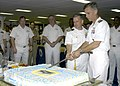 US Navy 070322-N-2636M-019 Capt. Richard P. Snyder and Capt. David Hulse cut the cake during a change of command reception held aboard amphibious assault ship USS Bataan (LHD 5).jpg