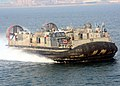 US Navy 070323-N-6710M-001 A landing craft air cushion (LCAC) prepares to enter the well deck of dock landing ship USS Tortuga (LSD 46) while passing by amphibious transport dock USS Juneau (LPD 10).jpg