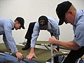 US Navy 071023-N-1008D-001 Sailors assigned to guided-missile destroyer USS Russell (DDG 59) assemble cots for potential evacuees as part of evacuation relief efforts taking place on board Naval Station San Diego.jpg