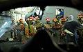 US Navy 071109-N-4774B-054 Sailors don firefighting ensembles during a general quarters drill aboard the amphibious assault ship USS Tarawa (LHA 1).jpg