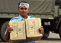 US Navy 071203-M-3095K-024 A Bangladeshi man helps on load boxes of food to a waiting CH-46E Sea Knight helicopter from the 22nd Marine Expeditionary Unit (MEU) (Special Operations Capable) at Barisal Airfield.jpg