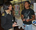 US Navy 080609-N-9268E-017 Capt. Cynthia Macri, an obstetrics and gynecology physician serving as the Chief of Naval Operations special assistant for diversity, speaks with a student during the Science, Service, Medicine and Me.jpg