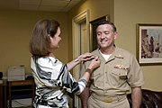 US Navy 080804-N-8273J-062 Vice Adm. Judge Advocate General (JAG) Bruce MacDonald is pinned by his wife, Karen
