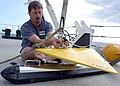US Navy 080907-N-3970R-001 Institute for Exploration engineer Dave Wright prepares a side scan sonar for launch during an at-sea capabilities demonstration aboard the Military Sealift Command oceanographic survey ship USNS Path.jpg