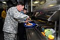 US Navy 081127-N-4584J-014 U.S. Army Gen. David H. Patraeus prepares himself a plate after serving Thanksgiving dinner.jpg