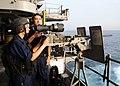 US Navy 090301-N-2562S-001 Aviation Ordnanceman Airman Rex Badorrek and Gunner's Mate 3rd Class Victoria Lindsey man a .50 caliber gun mount on the fantail of the aircraft carrier USS Theodore Roosevelt (CVN 71).jpg