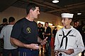 US Navy 090702-N-5366K-333 Chief Special Warfare Operator (SEAL) William Davis, assigned to the U.S. Navy Parachute Team the Leap Frogs, talks to a U.S. Navy Sea Cadet Corps cadet from the Seal Beach Battalion.jpg