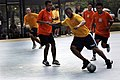 US Navy 090807-N-2725D-041 Interior Communication Specialist 3rd Class Daniel Western, assigned to the guided-missile frigate USS Crommelin (FFG 37), battles for possession during a futsal game against sailors from the Royal Br.jpg
