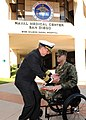 US Navy 091107-N-6326B-031 Capt. Ted J. Lucas, commodore, Explosive Ordnance Disposal Group 1, presents the Purple Heart medal to Staff Sgt. Jesse A. Cottle at Naval Medical Center San Diego.jpg