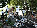 US Navy 100228-N-9112H-010 Senior Chief Master-at-Arms Dennis Zmija participates in a United Nations sponsored trash clean-up project near the port of Moroni.jpg