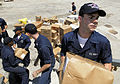 US Navy 100728-N-7638K-253 Operations Specialist Seaman Thaddeus Hall, from Myrtle Beach, S.C., passes a box of supplies during an all hands working party aboard the Oliver Hazard Perry-class guided-missile frigate USS Taylor (.jpg