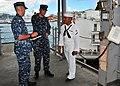 US Navy 100804-N-5006D-002 Seaman Apprentice Adam McMahon receives instruction from Ensign John Sullivan and Senior Chief Hull Maintenance Technician Byron Gibbs.jpg