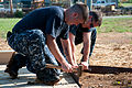 US Navy 100807-N-6466B-079 Sailors install landscaping border at the site of a new Habitat for Humanity home.jpg