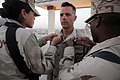 US Navy 100916-N-0475R-137 Chief Equipment Operator Thomas Colesanti, center, assigned to the Naval Mobile Construction Battalion (NMCB) 5, has his.jpg
