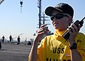 US Navy 100927-N-2811A-078 Linus Phillips communicates with Cmdr. Charles Hayden from the flight deck of USS Nimitz (CVN 68) during a tour.jpg