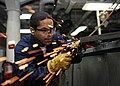 US Navy 101006-N-6427M-078 Hull Maintenance Technician Fireman Ruben Torres of Bloomington, Ind., grinds down excess welds during the fabrication o.jpg