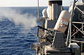 US Navy 101026-N-6632S-045 A Close-In Weapons System (CIWS) aboard the guided-missile cruiser USS Gettysburg (CG 64) is fired during a sinking exer.jpg