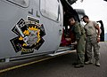 US Navy 110810-N-RM525-815 Chief Naval Air Crewman Justin Crowe prepares an injured boy for transport by local paramedics in San Jose, Costa Rica.jpg