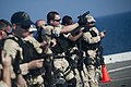 US Navy 111231-N-PB383-595 Hull Technician 1st Class James Reams, assigned to the visit, board, search, and seizure team, fires a 9mm pistol at a t.jpg