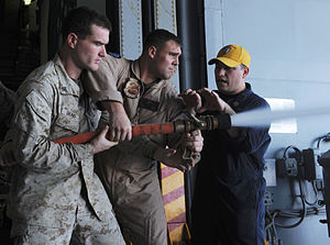 US Navy 120111-N-EK905-076 Hull Technician 1st Class Ralph Casillas shows Marines assigned to the 11th Marine Expeditionary Unit (11th MEU) how to.jpg
