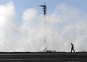 US Navy 120124-N-VA840-027 Aviation Boatswain's Mate (Equipment) 2nd Class Zachary J. Everett inspects a catapult.jpg