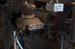 US Navy 120208-N-PB383-424 A Sailor guides equipment onto a landing craft, air cushion.jpg