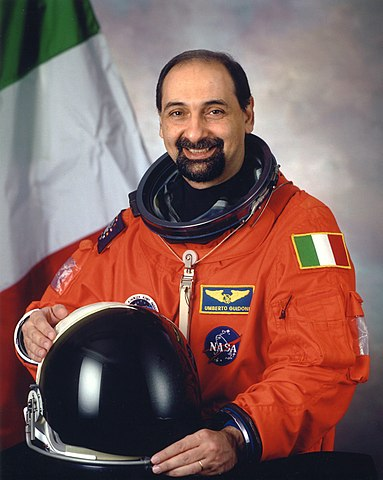 "Italian astronaut Umberto Guidoni, NASA photo (2001)<br /><i>Source:</i> <a href=""https://commons.wikimedia.org/wiki/File:Umberto_Guidoni_portrait.jpg"" rel=""external"">Wikipedia</a> 383px-Umberto_Guidoni_portrait.jpg"