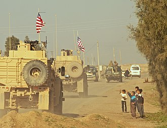 A convoy of U.S. soldiers during the American-led intervention in the Syrian Civil War, December 2018 Us troops in syria.jpg