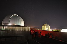 Observatory built in 2009 on top of the SER building as seen at night.