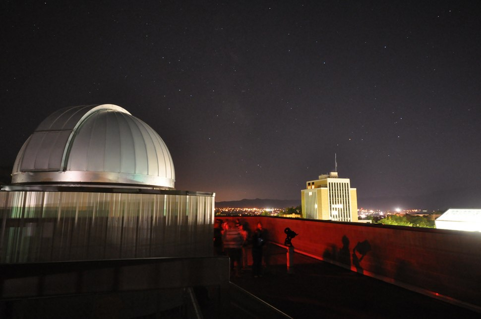 Utah State University observatory and business building at night