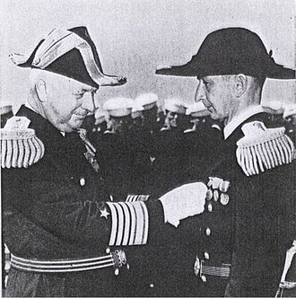 Edward C. Kalbfus - As Commander Battle Force (left), awarding the Navy Cross to Lieutenant Arthur F. Anders, August 27, 1938
