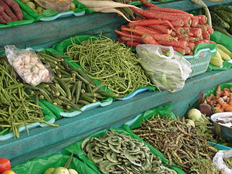 Maharashtrian cuisine - Common vegetables used as seen on a market cart in Pune