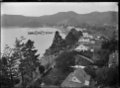 View of Russell along the foreshore, with Hone Heke's flagstaff. ATLIB 287799.png